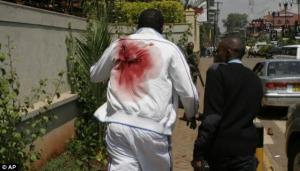 A purported victim of the Westgate Mall shooting in Nairobi, Kenya, who has just been shot in the back,  is seen runningfor his life on September 21, 2013.