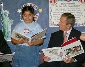 George W. Bush reads a children's book (upside down) while the U.S. comes under attack.