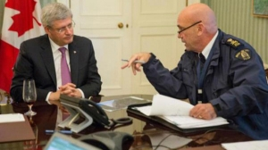 "Stephen Harper receives a purported briefing from RCMP Commissioner Robert ""Bob"" Paulson."