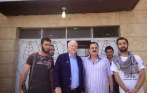 "U.S. Senator John McCain (Likud, Arizona) poses with ISIS ""fighters"" on May 27, 2013."