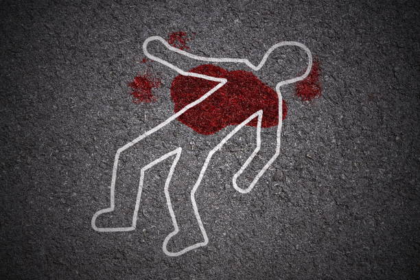white shape of body and blood stains on asphalt texture